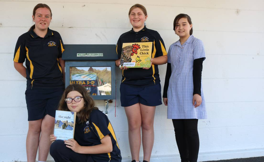 READ A BOOK: Year seven mental health ambassadors Sophia Cornish, Kendra Bilston, Maggie McLean and Nargis Akbari with the new street library. Photo: ELISABETH CHAMPION